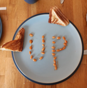 Baked beans spelling out UP